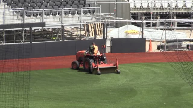 london stadium is halfway through its transformation from a football pitch to a baseball field. boston red sox will play new york yankees in london... - ニューヨーク・ヤンキース点の映像素材/bロール