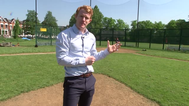 London Stadium to host two Major League Baseball games ENGLAND London Finsbury Park EXT Reporter throwing ball Back view of baseball player hitting...