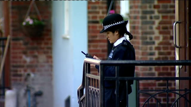 london stockwell block of flats where 45yearold robert daley was found stabbed to death low angle shot of flat entrance police officer on duty at... - ストックウェル点の映像素材/bロール