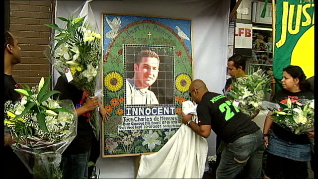 london stockwell underground station ext mosaic memorial for jean charles de menezes being unveiled vivian figueiredo interview sot - stockwell stock videos and b-roll footage