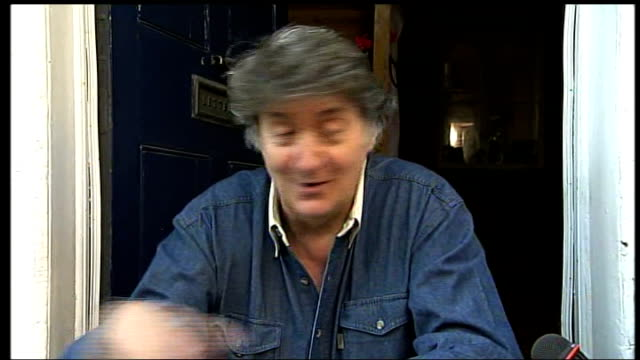 london street appears in guide to 500 places to see before they disappear; tom conti interview sot - tom conti stock videos & royalty-free footage