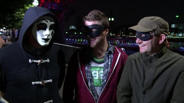 "london street art; england: london: ext at night various of anonymous street artists ""the phantom framers"" placing frame around lexington street road... - treasure hunt stock videos & royalty-free footage"