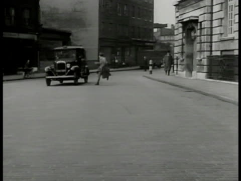 london street cab driving down man running from building to catch cab grabs onto side of cab jumps off cab driving away man running back toward... - 1949 stock videos and b-roll footage