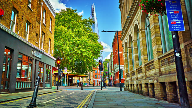 london street. office building. hotel. tree. time lapse. hyper lapse. day summer. the shard - general view stock videos & royalty-free footage