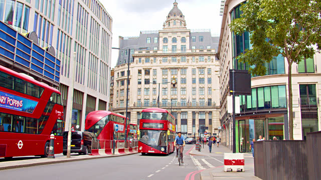 london street. red bus. tree. downtown. - double decker bus stock videos & royalty-free footage