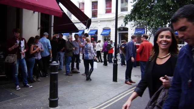 london street scene at pub in soho - outdoors stock videos & royalty-free footage