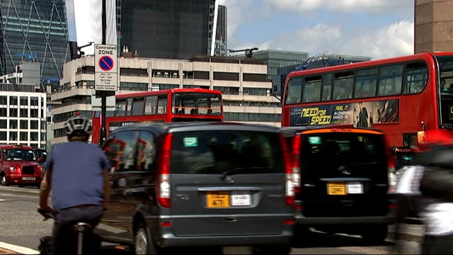 london taxi drivers demonstration over lack of taxi rank at the shard england london ext london taxi cabs across london bridge with other traffic... - taxi rank stock videos & royalty-free footage