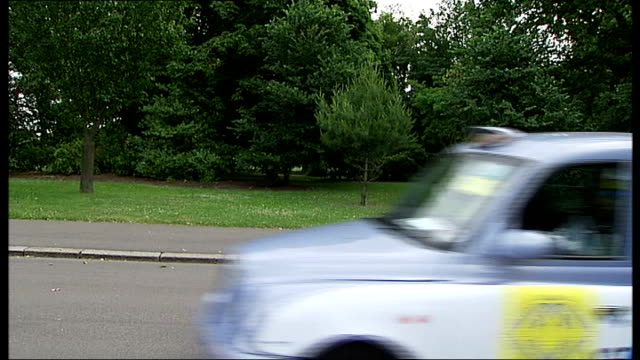 london taxi drivers takes disadvantaged children to the seaside convoy of taxi cabs leaving victoria park - victoria park london stock videos & royalty-free footage