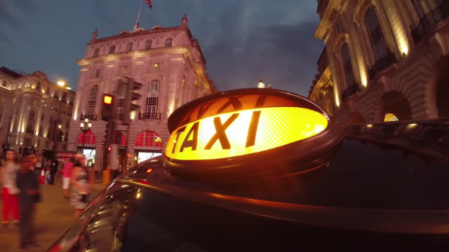 london taxi driving through west end - hackney video stock e b–roll