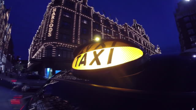 london taxi driving through west end - taxi video stock e b–roll