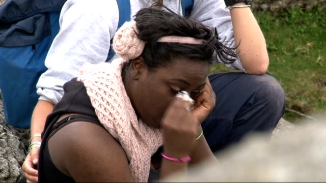 london teenagers return from snowdonia trip t13081016 snowdonia ext ermani rose being comforted by tope sot - snowdonia video stock e b–roll
