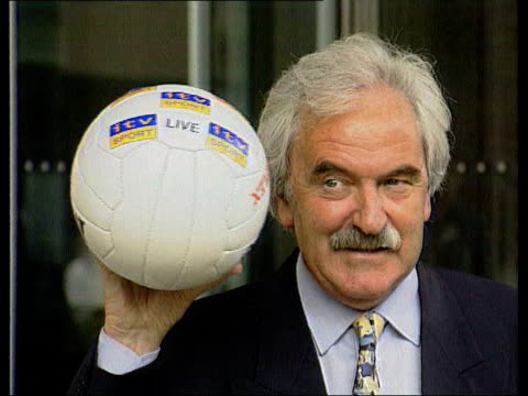 Television Centre Desmond Lynam posing for photocall holding football following announcement of his move to ITV Murray Walker Martin Brundle...