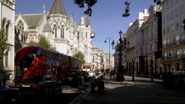 london the strand road and royal courts of justice - royal courts of justice stock videos & royalty-free footage