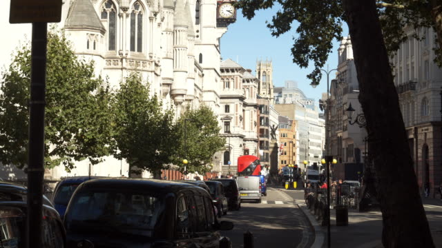 london the strand road at the royal courts of justice - royal courts of justice stock videos & royalty-free footage