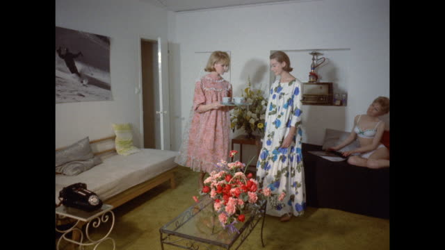 1961 - london - three women having coffee in their flat - nightdress stock videos & royalty-free footage