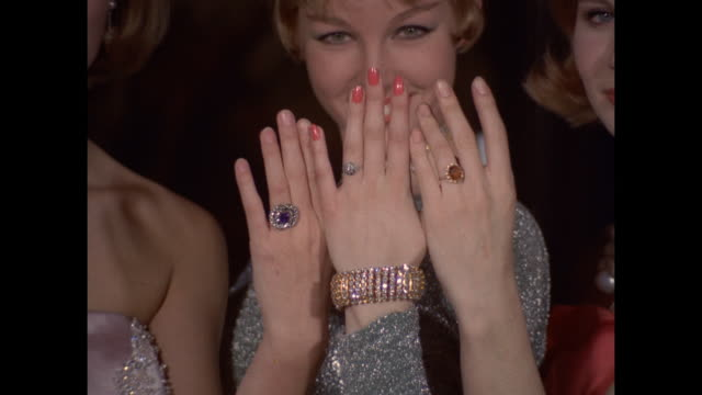 1961 - London - three young women show their rings