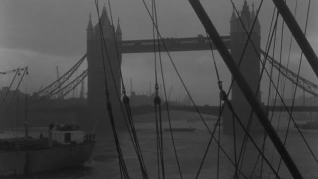 dx - london - through ropes and masts toward  tower bridge across b.g. - thames river - very scenic shot - b&w. - mast stock videos & royalty-free footage