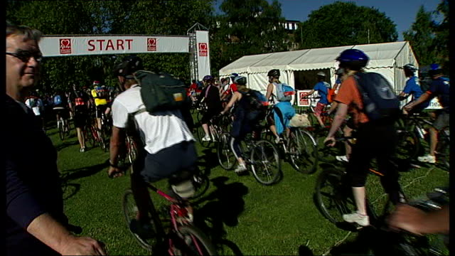 london to brighton bike ride; england: london: clapham: ext various of participants in annual london to brighton bike ride cycling along cyclist on... - tutu stock videos & royalty-free footage
