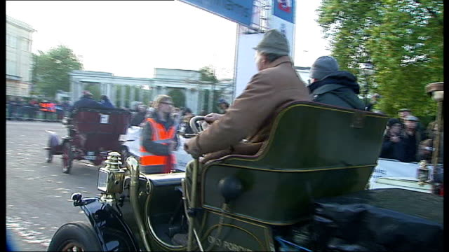 london to brighton veteran car run england london hyde park ext veteran cars along in park franklyn car vox pop union jack flag waved to start race... - start flag stock videos & royalty-free footage