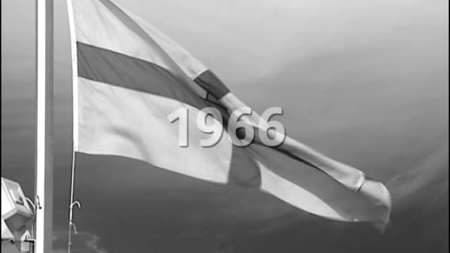 london tonight search for a viewer's england world cup song england ext b/w england flag flying with graphic '1966' overlaid - 1966 stock-videos und b-roll-filmmaterial