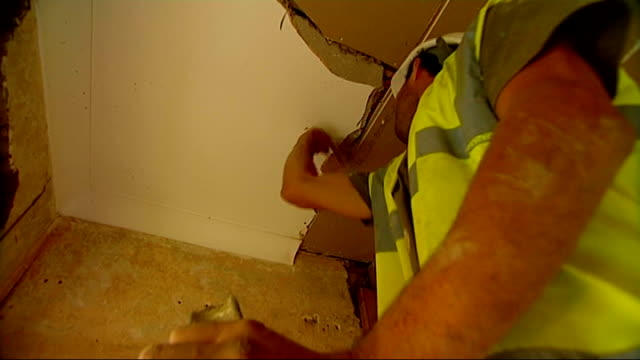 tony petim standing outside house builders working on house renovation ext tony petim interview sot builders renovating house / kitchen door... - replacement stock videos and b-roll footage