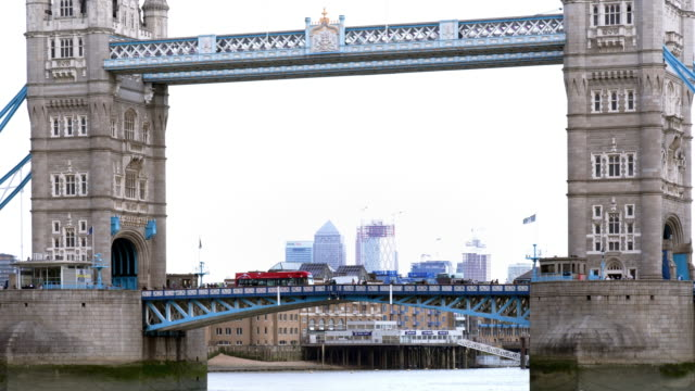 london tower bridge and canary wharf skyline - bridge built structure stock videos & royalty-free footage