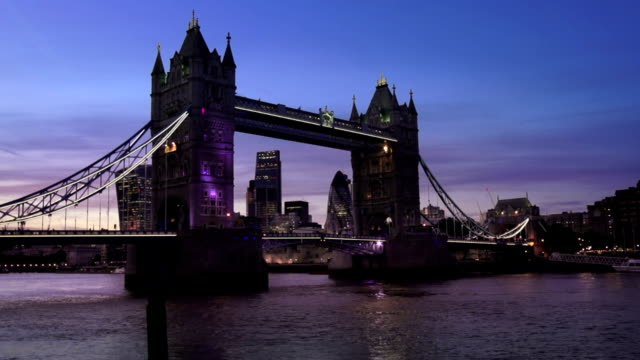 london tower bridge and the city at night - sir norman foster building stock videos & royalty-free footage
