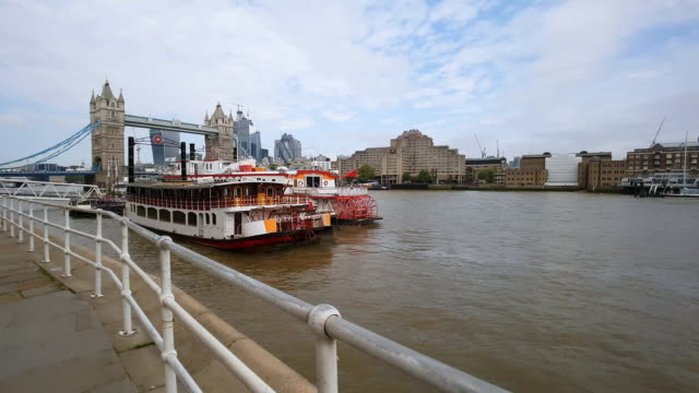 london tower bridge and the city skyline from butler's wharf - tower bridge stock videos & royalty-free footage