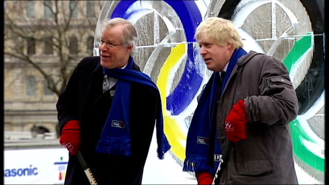 london trafalgar square ext mayor of london boris johnson and canadian high commissioner jim wright posing with ice hockey sticks in front of ice... - admiral nelson stock videos and b-roll footage
