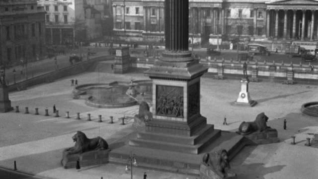 london traffic flows around trafalgar square and the nelson monument in 1936. - 1936 stock videos & royalty-free footage