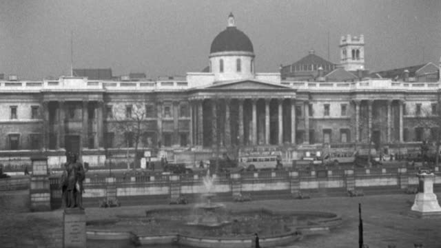 london traffic travels slowly past the national art gallery and trafalgar square in 1936. - 1936 stock videos & royalty-free footage