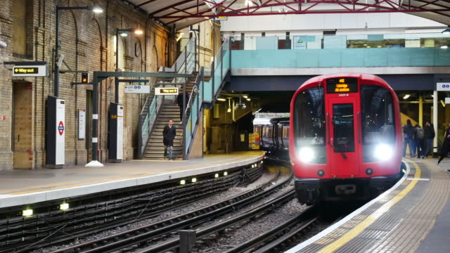 4k london train tube underground station, passengers in rush hour, england, uk - image stock videos & royalty-free footage