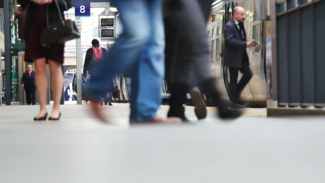 4k london train tube underground station, passengers in rush hour, england, uk - railway station platform stock videos and b-roll footage