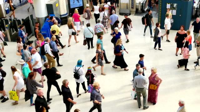london train tube underground station, passengers in rush hour, england, uk - public transport stock videos & royalty-free footage