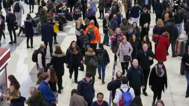 4K London train tube underground station, passengers in rush hour, England, UK