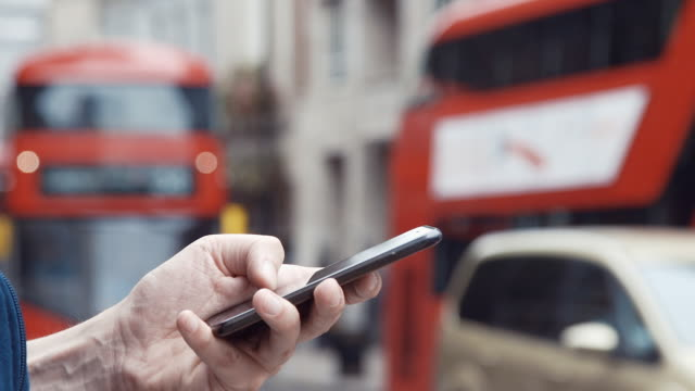 London transportation and smartphone (slow motion)