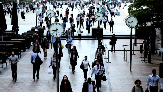 london uk canary wharf city commuters clocks people business - canary wharf stock videos & royalty-free footage