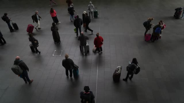 members of the public self distancing themselves in a quiet kings cross train station at coronavirus in london on march 17, 2020 in london, england. - station stock videos & royalty-free footage