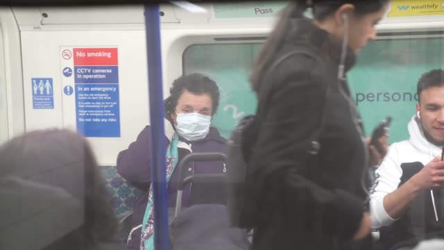 an elderly person wears a face mask on the london underground at coronavirus outbreak in london on march 18, 2020 in london, england. - human face stock videos & royalty-free footage