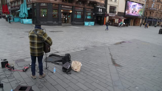 busker plays to a near empty leicester square at coronavirus outbreak in london on march 19, 2020 in london, england. - leicester square stock videos & royalty-free footage