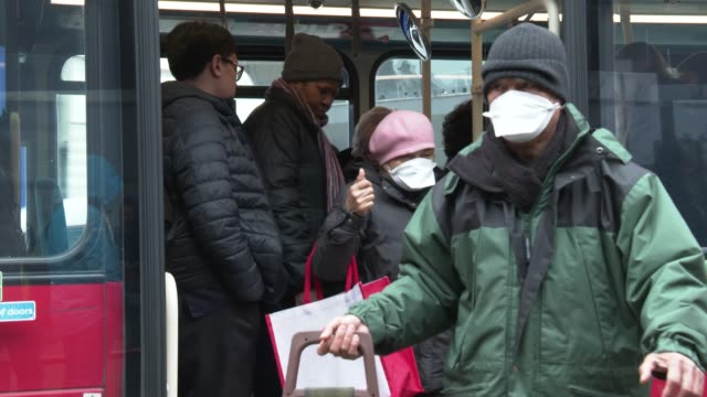 member of the public wear face mask as they get off a london transport bus at coronavirus outbreak in london on march 19, 2020 in london, england. - infectious disease stock videos & royalty-free footage