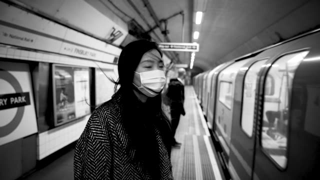 member of the public wears a face mask in the london underground at travel - the coronavirus pandemic, london on march 21, 2020 in london, england. - black and white stock videos & royalty-free footage