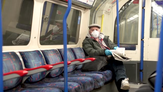 an elderly man wearing a face mask and protective gloves of the london underground at travel - the coronavirus pandemic, london on march 23, 2020 in... - senior adult stock videos & royalty-free footage