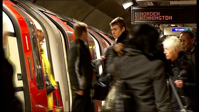 london underground 150th anniversary: poetry on the tube; date unknown commuters getting on and off tube train - literatur stock-videos und b-roll-filmmaterial