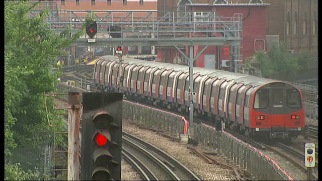 24hour strike dates london various of trains along commuters along ext london underground sign - itv london tonight weekend stock videos & royalty-free footage
