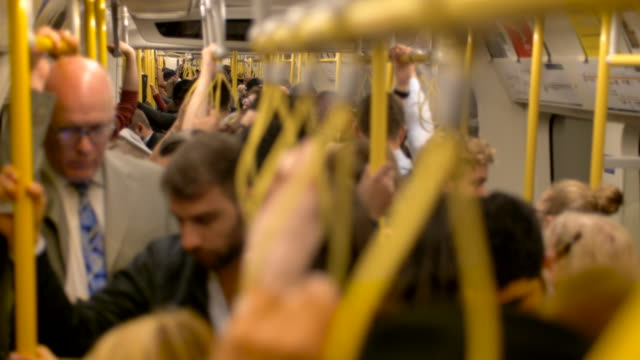 london underground - crowded carriage - commuters squashed on way to work - busy stock videos & royalty-free footage