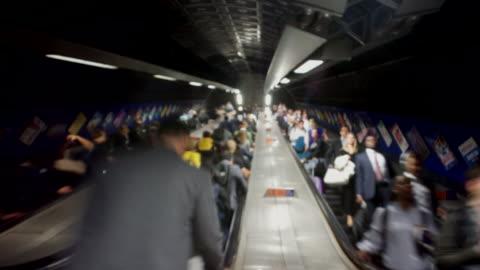 london underground escalator crowd of commuters time lapse blurred - pendlare bildbanksvideor och videomaterial från bakom kulisserna