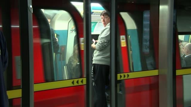 jubilee line to begin night tube service england london waterloo underground station int sadiq khan talking with others on station platform... - itv london lunchtime news点の映像素材/bロール