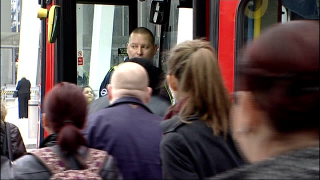 london underground proposed strike is suspended; london: bus supervisor standing as people board busy bus people waiting at bus stop - newspaper strike stock videos & royalty-free footage