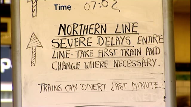 signal system failure on northern line england london ext commuter looking at 'northern line severe delays' sign at railway station 'northern line... - railway signal stock videos & royalty-free footage